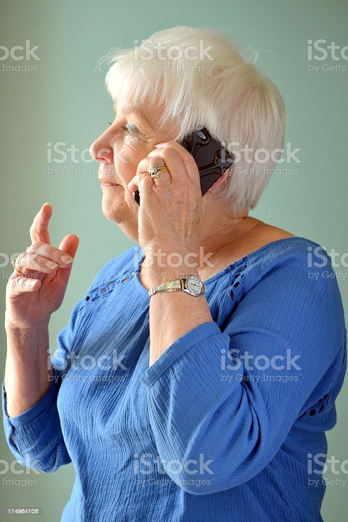 Attractive Senior woman using mobile phone royalty-free stock photo