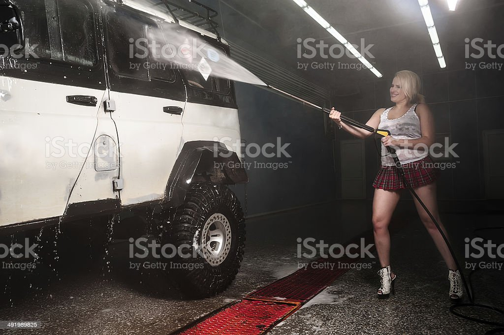 Attractive sexy woman washing the car stock photo