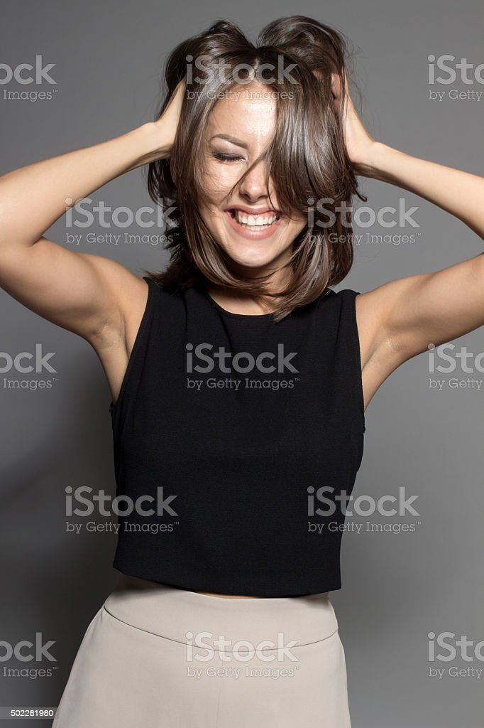 attractive shy sexy model posing in studio wearing black shirt stock photo
