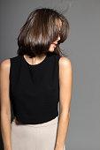attractive shy sexy model posing in studio wearing black shirt