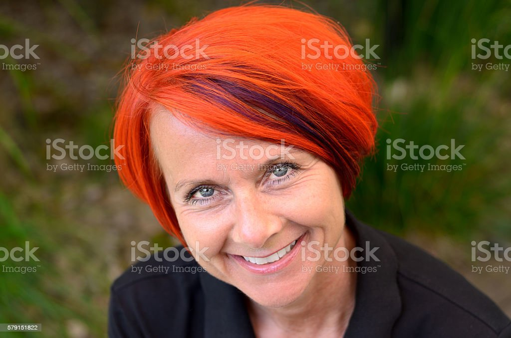 Attractive sincere smiling redhead woman stock photo