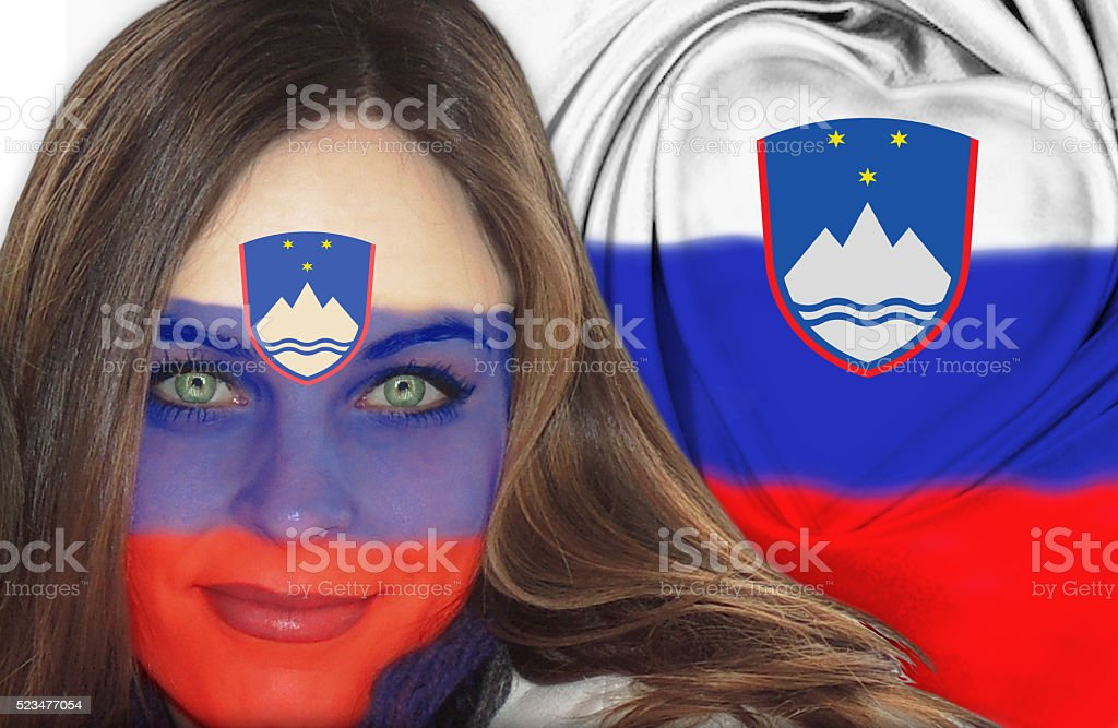 Attractive Slovenian woman in front of flag stock photo