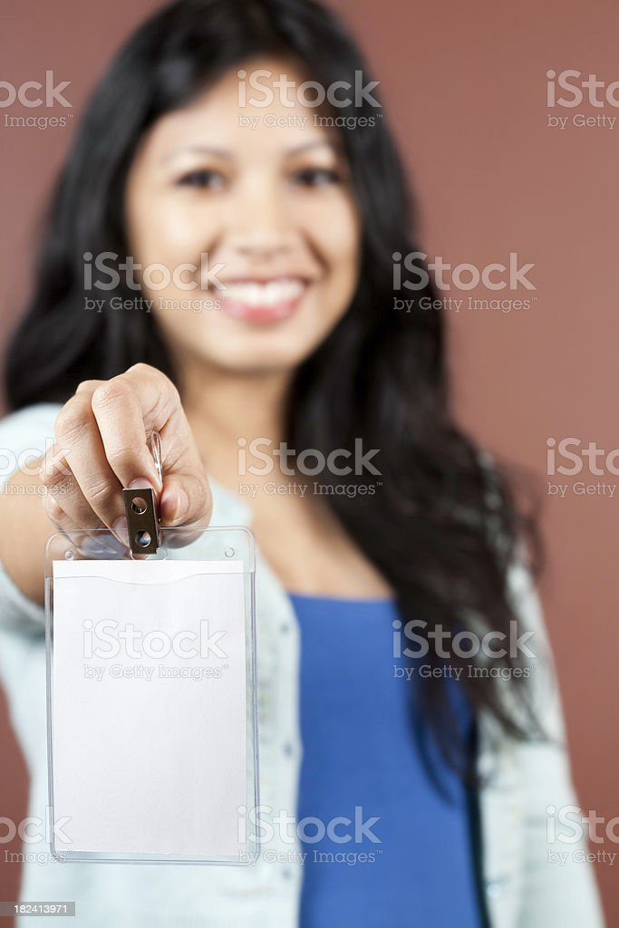 Attractive Smiling Asian Woman Holding Blank Tag royalty-free stock photo