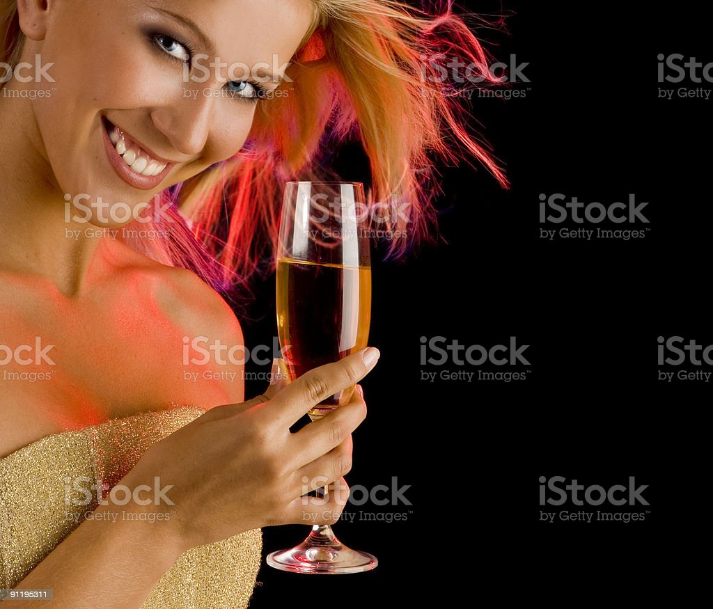 Attractive smiling blonde with champagne at the red disco lights. royalty-free stock photo