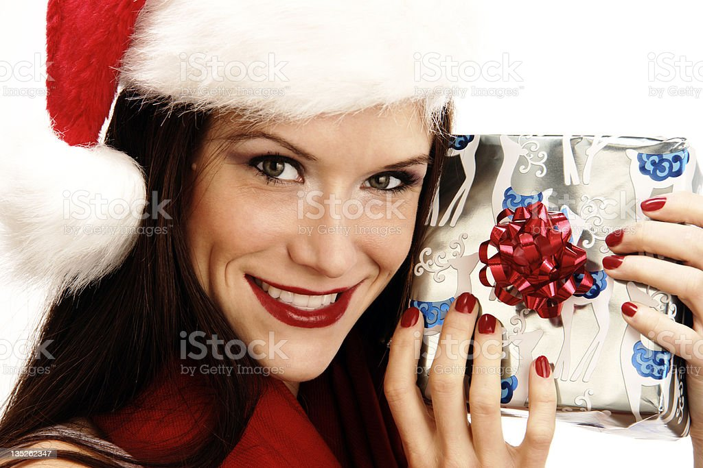 Attractive Smiling Female Gift Giver Holds Wrapped Christmas Package stock photo