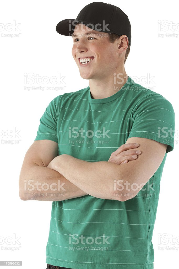 Attractive smiling man standing with arms crossed stock photo