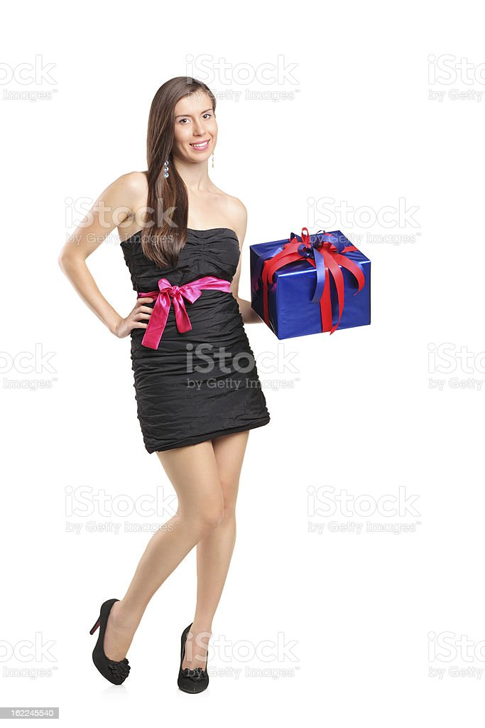 Attractive smiling woman holding a gift royalty-free stock photo