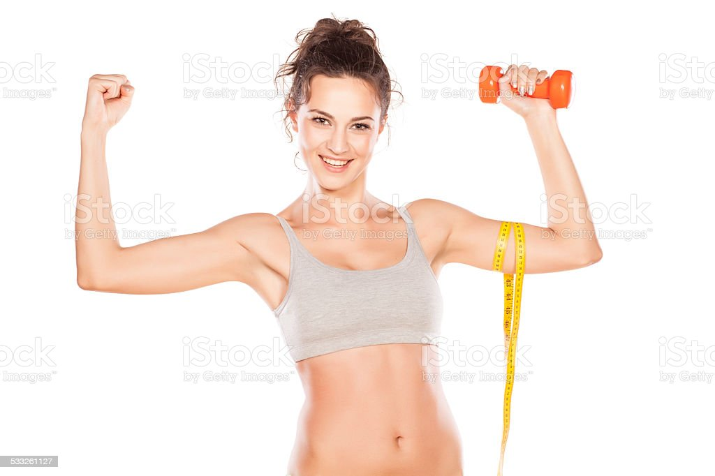 Attractive sporty girl showing her beautiful arms stock photo