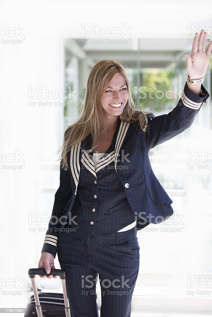 Attractive stewardess with uniform royalty-free stock photo