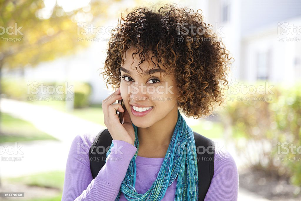 Attractive student on the phone royalty-free stock photo
