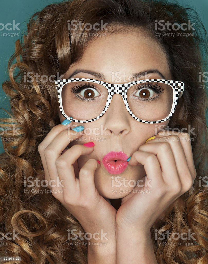 Attractive surprised young woman wearing glasses stock photo