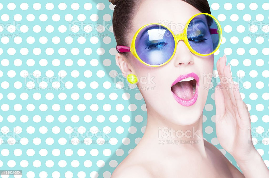 Attractive surprised young woman wearing sunglasses stock photo