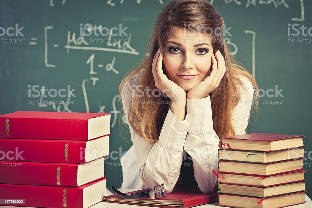 Attractive teacher in a classroom royalty-free stock photo