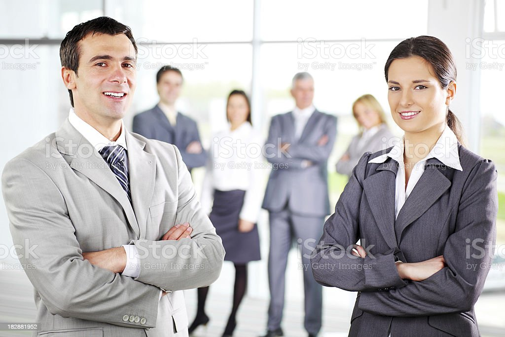 Attractive team of  business people with crossed arms. royalty-free stock photo