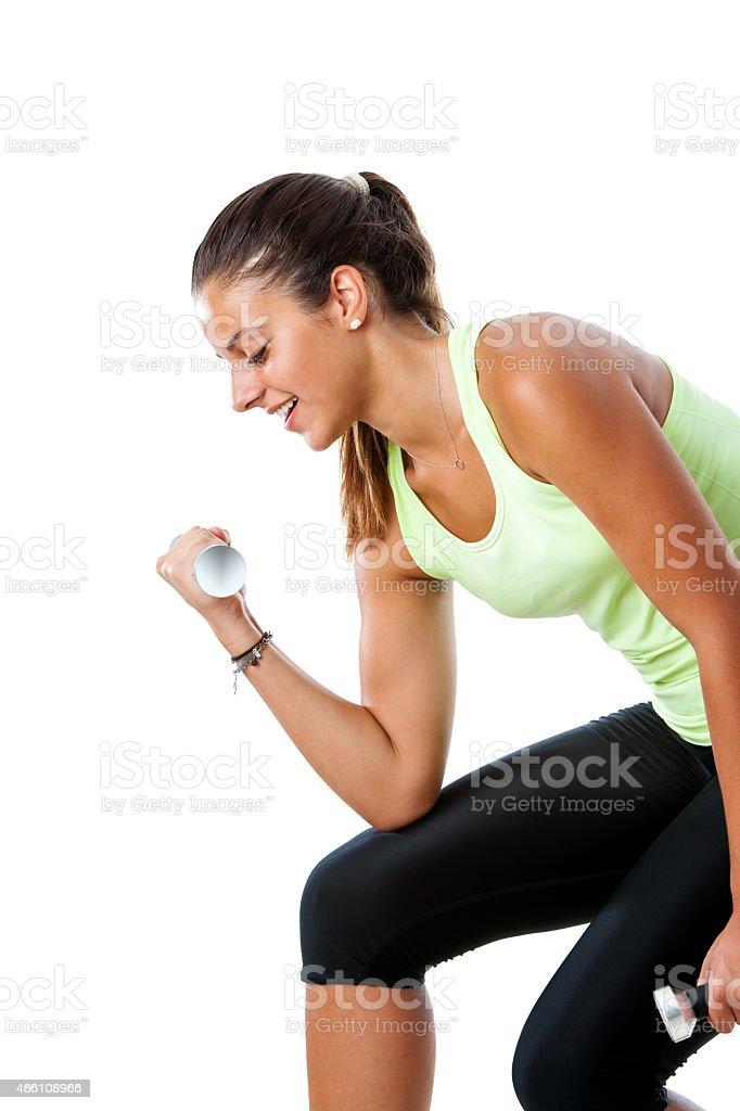Séduisante teen fille faire de l'exercice avec les poids et haltères. photo libre de droits