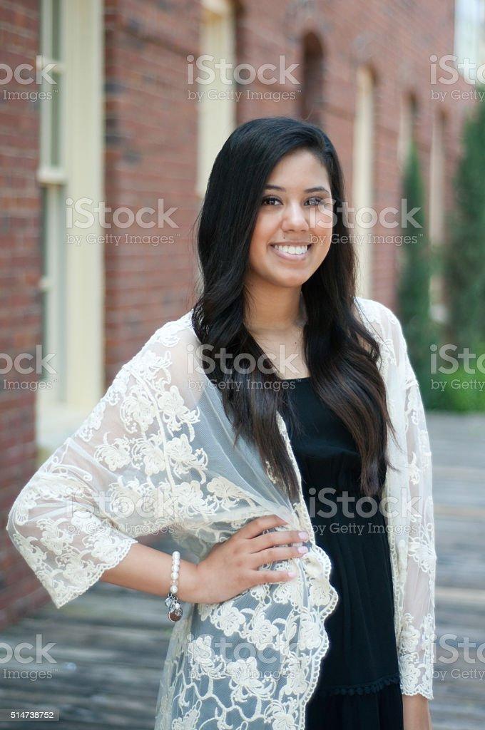 Attractive teen graduate stock photo