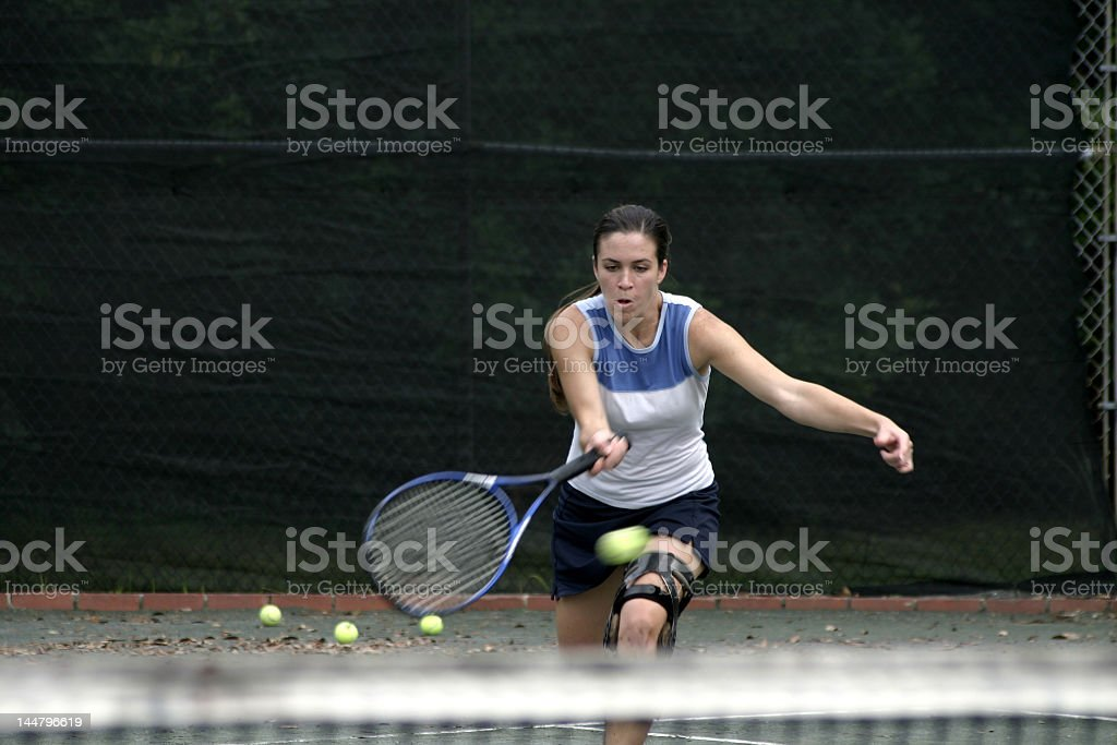 attractive tennis player in action royalty-free stock photo