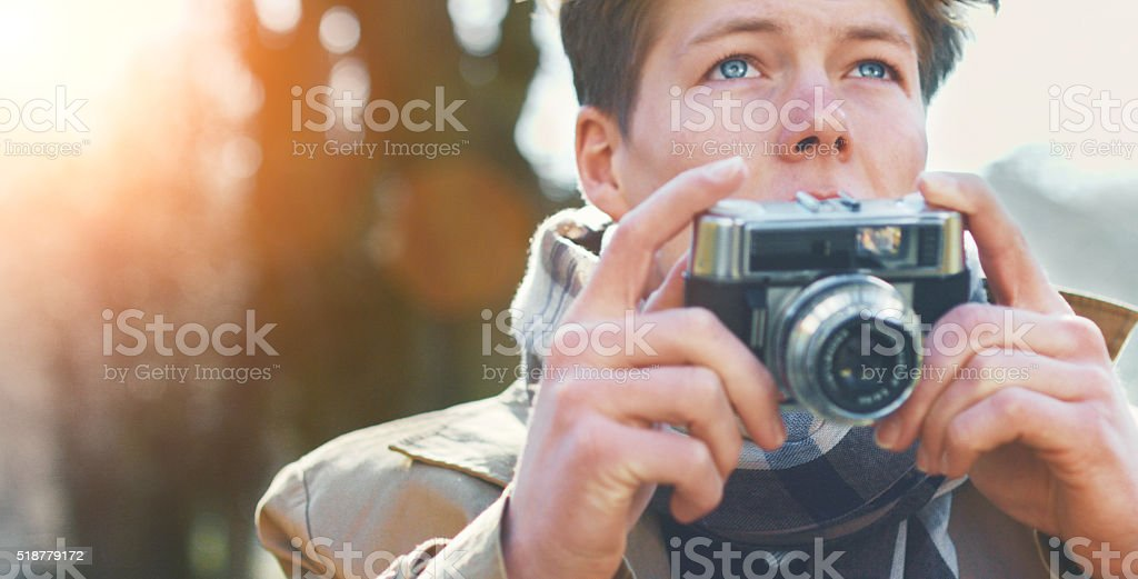 Attractive Tourist taking a photograph with vintage camera stock photo