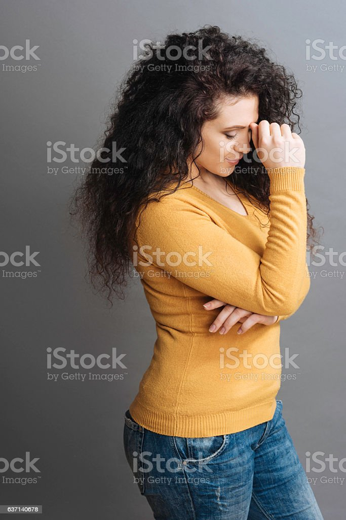 Attractive upset female tilting her head stock photo