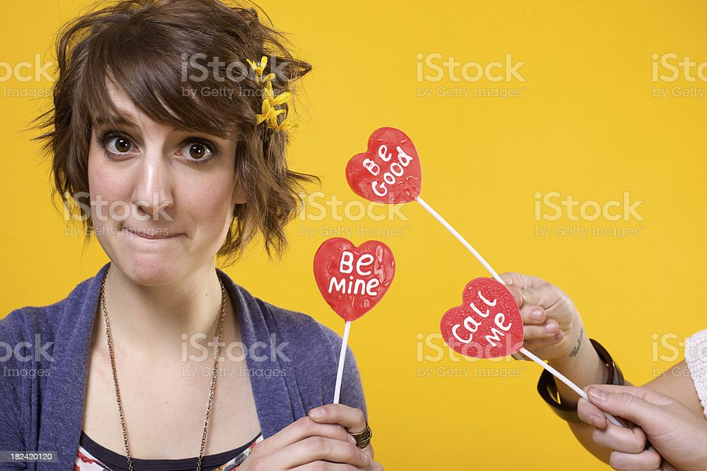 attractive Valentine heart lollipop girls royalty-free stock photo