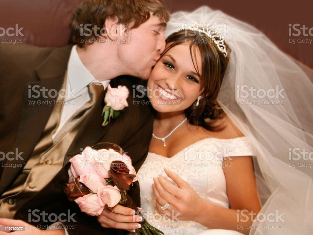 Attractive Wedding Dress Couple Kissing Portraits royalty-free stock photo