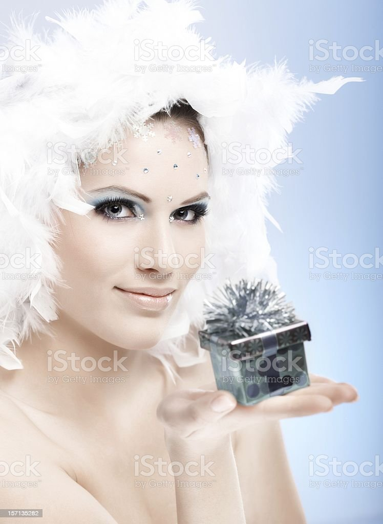 Attractive winter girl with present box royalty-free stock photo