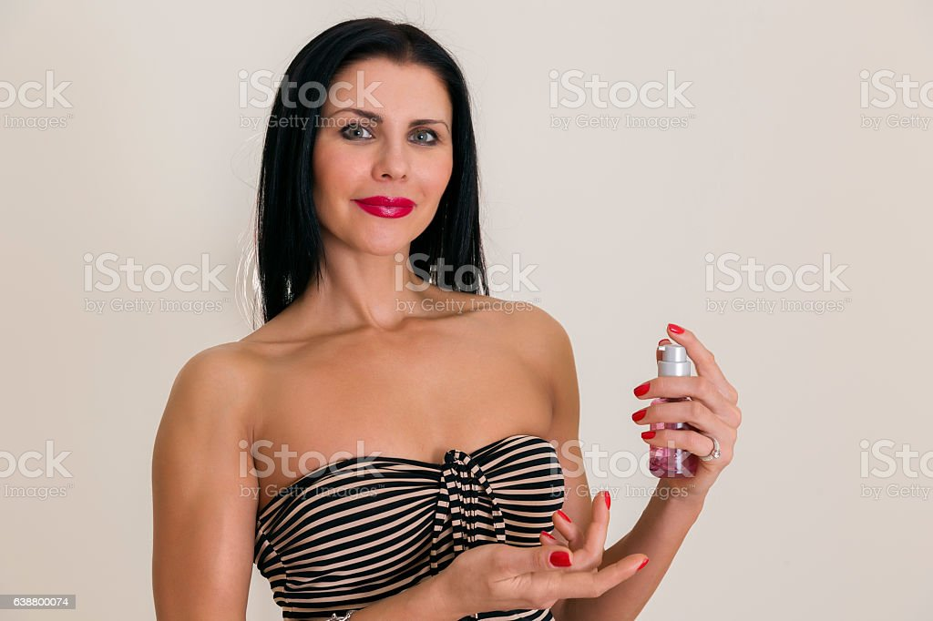 Attractive woman applaying gel on her hands stock photo