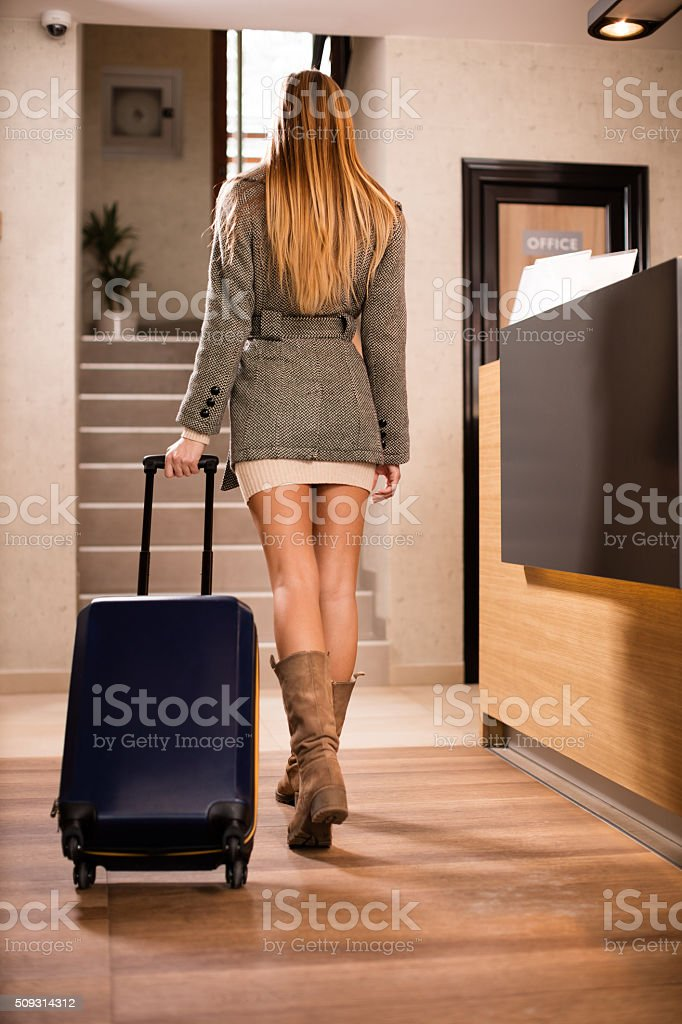 Attractive woman arrives in hotel stock photo