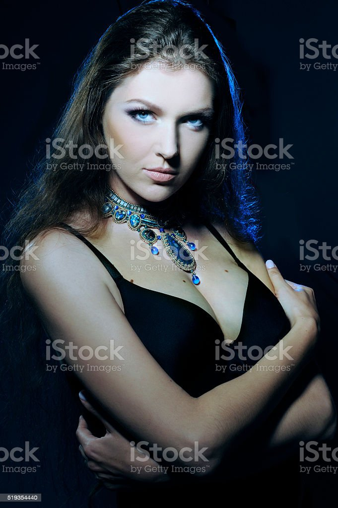Portrait, jewelry on the beautiful young woman, serious look,. stock photo