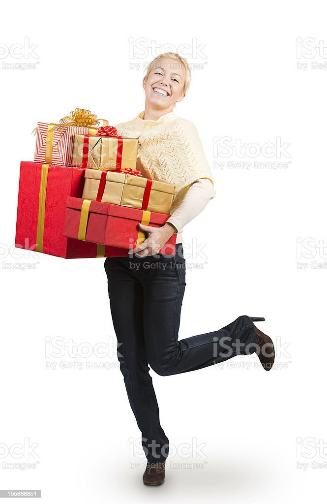 Attractive woman carrying a lot of Christmas presents royalty-free stock photo