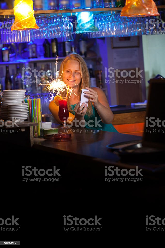 Attractive woman celebrating in a night club stock photo