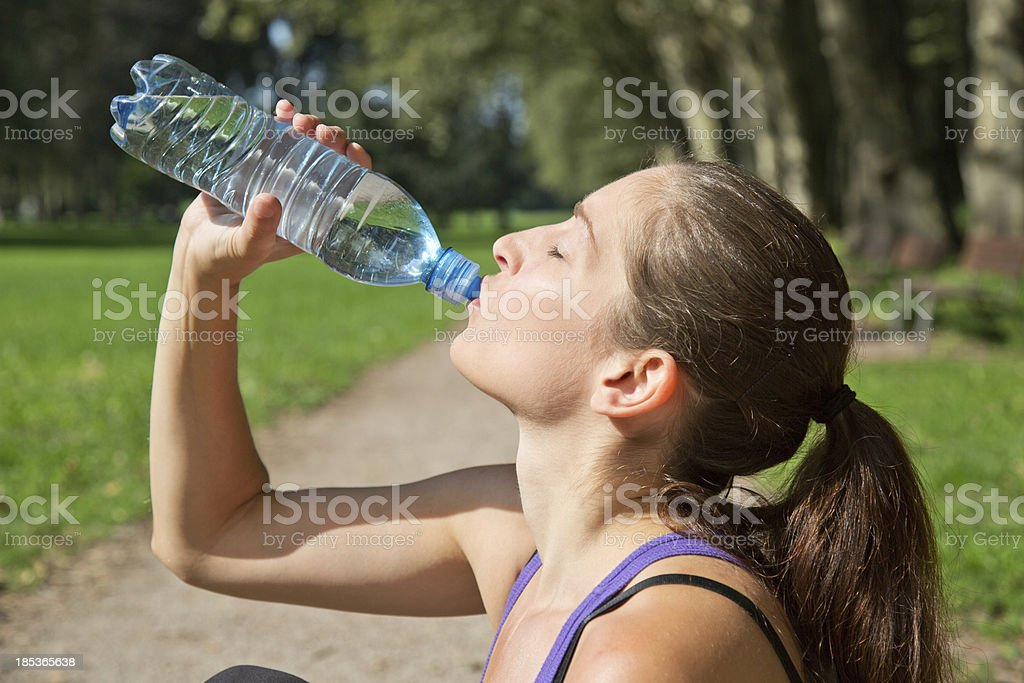 Attractive woman drinking water after sports royalty-free stock photo