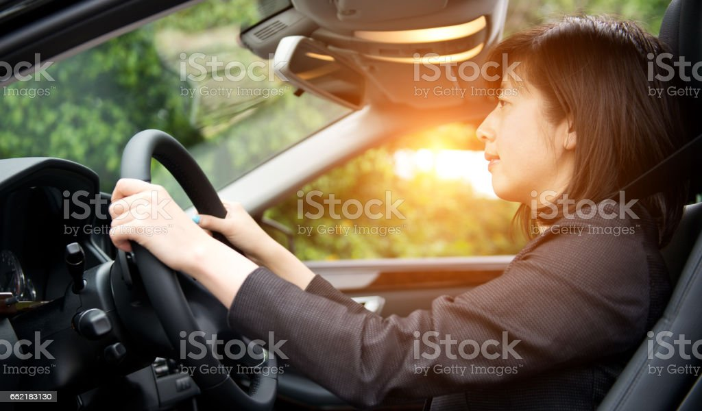 attractive woman driving a car stock photo