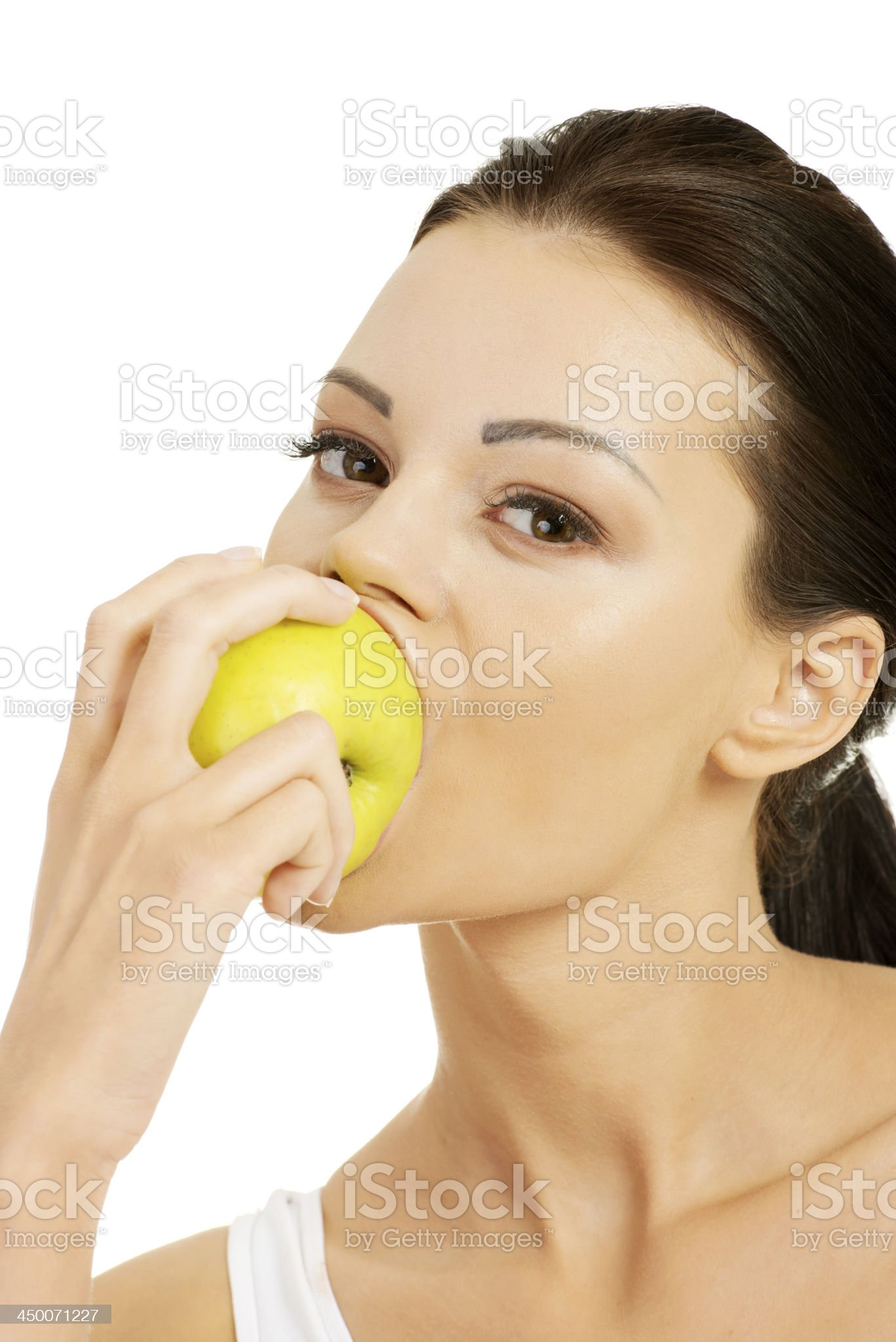 Attractive woman eating an apple. royalty-free stock photo