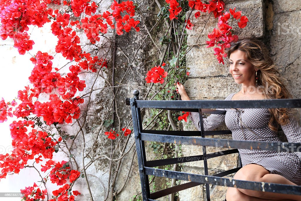 Attractive woman enjoying in garden stock photo
