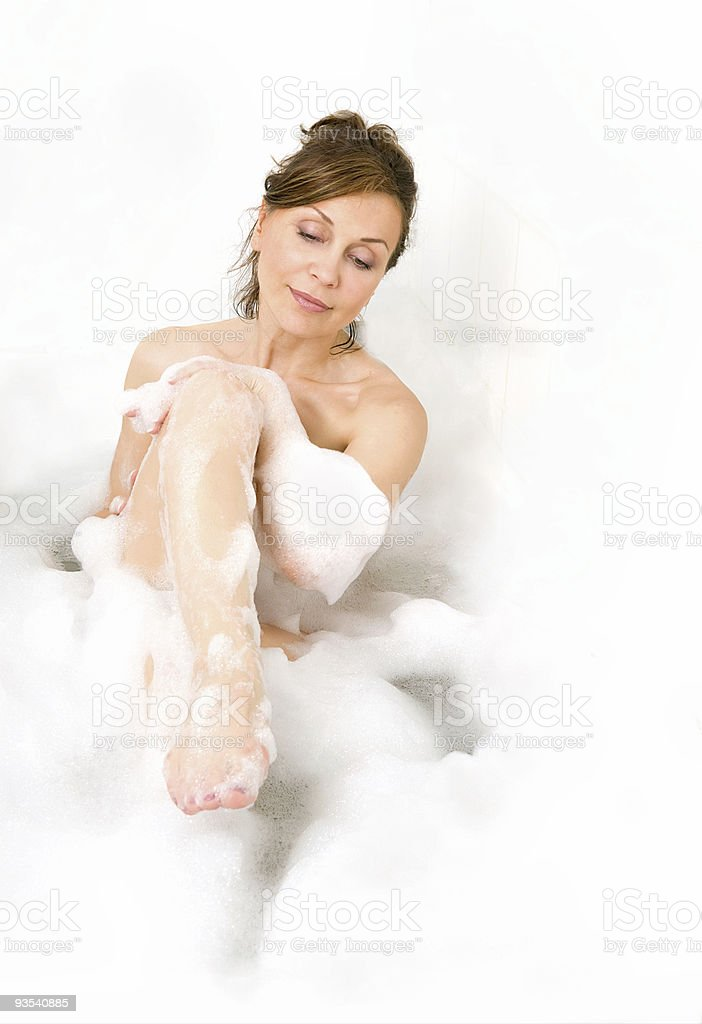Attractive woman enjoys  in the bathtub. royalty-free stock photo