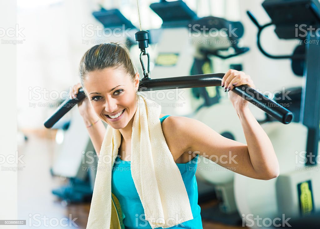 Attractive woman exercising at gym stock photo