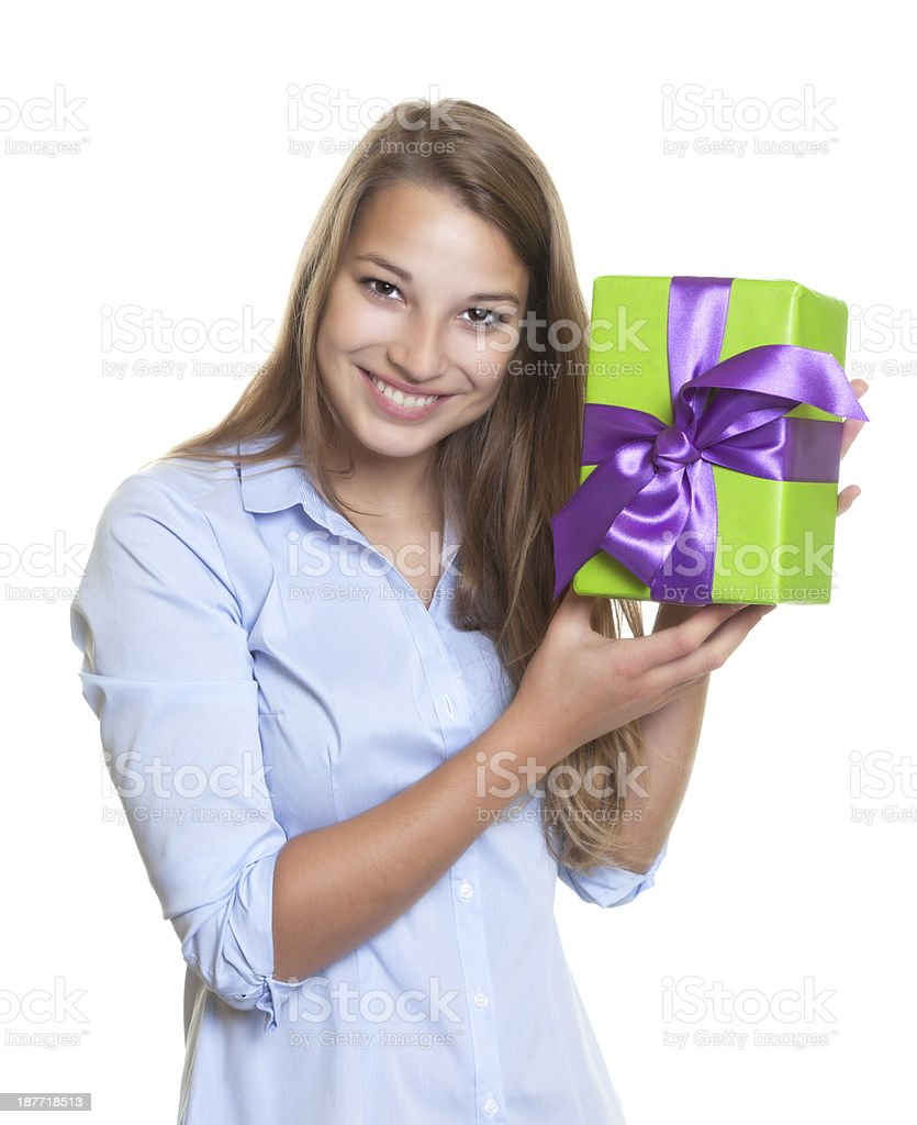 Attractive woman has a gift with ribbon in her hand royalty-free stock photo