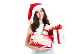 Attractive woman holding a gifts isolated.