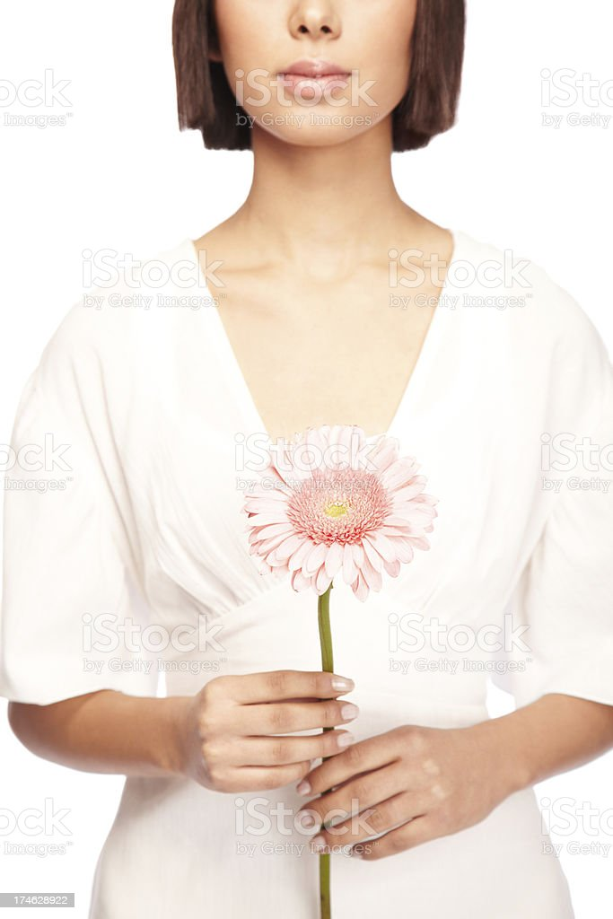 Attractive Woman Holding a Pink Gerber Daisy Flower stock photo