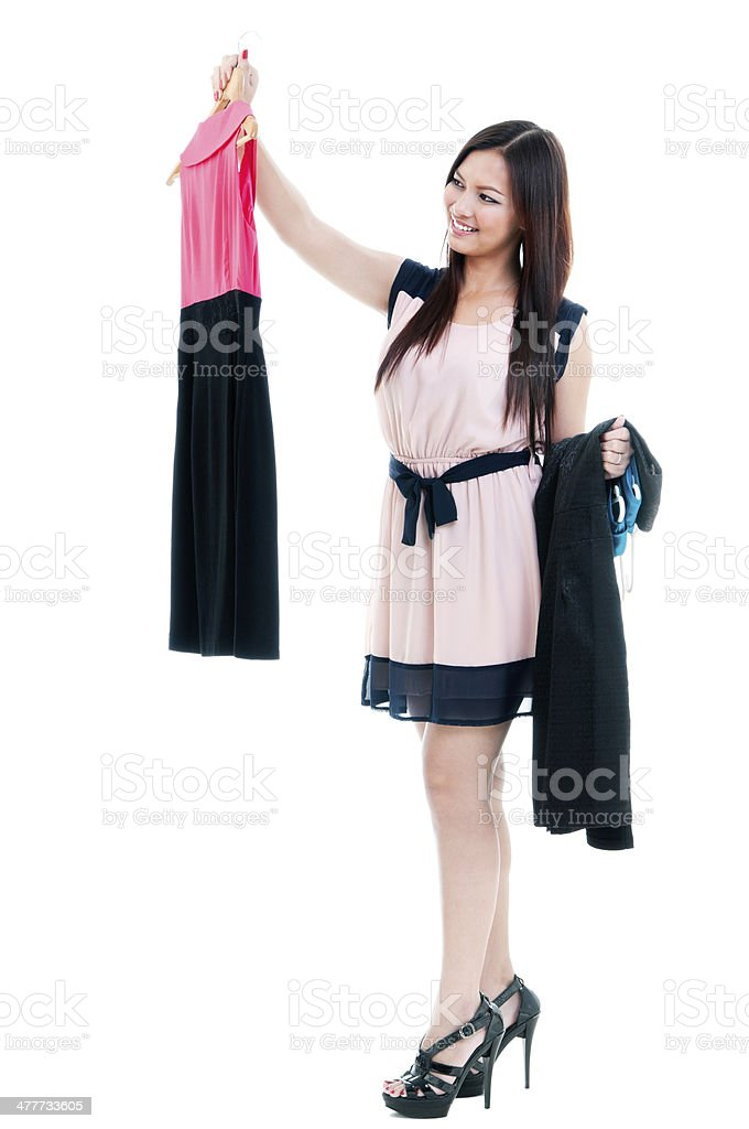 Attractive Woman Holding Dress stock photo