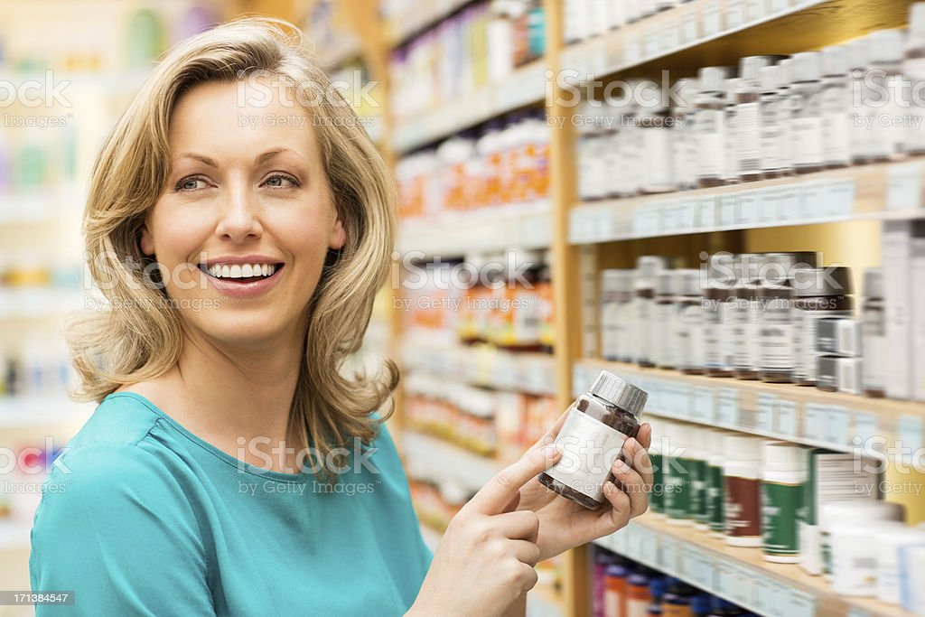 Attractive Woman Holding Pill Bottle royalty-free stock photo