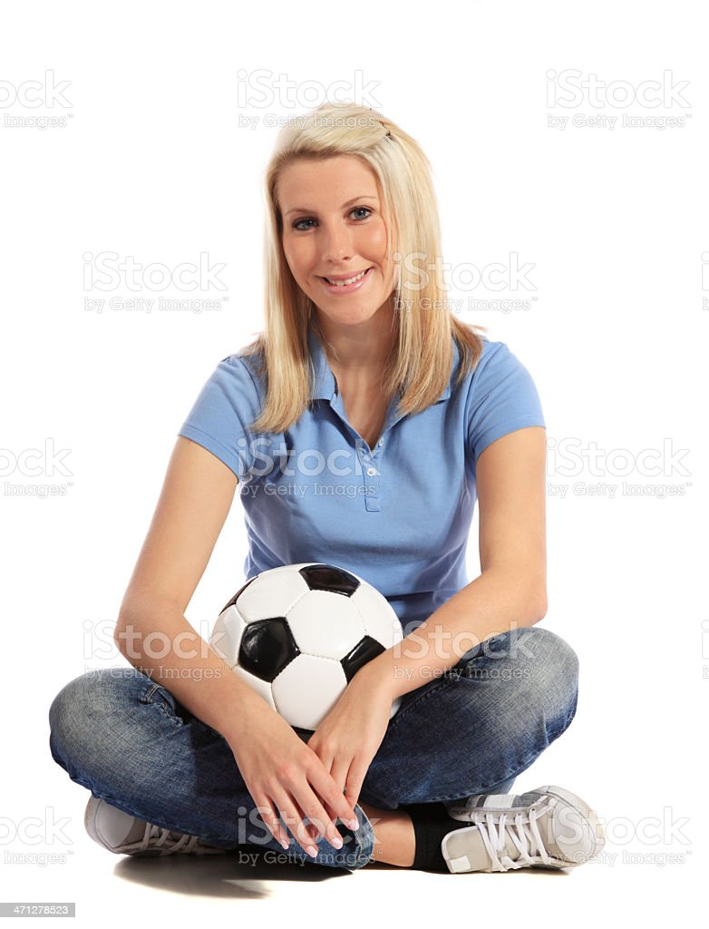 Attractive woman holding soccer ball stock photo
