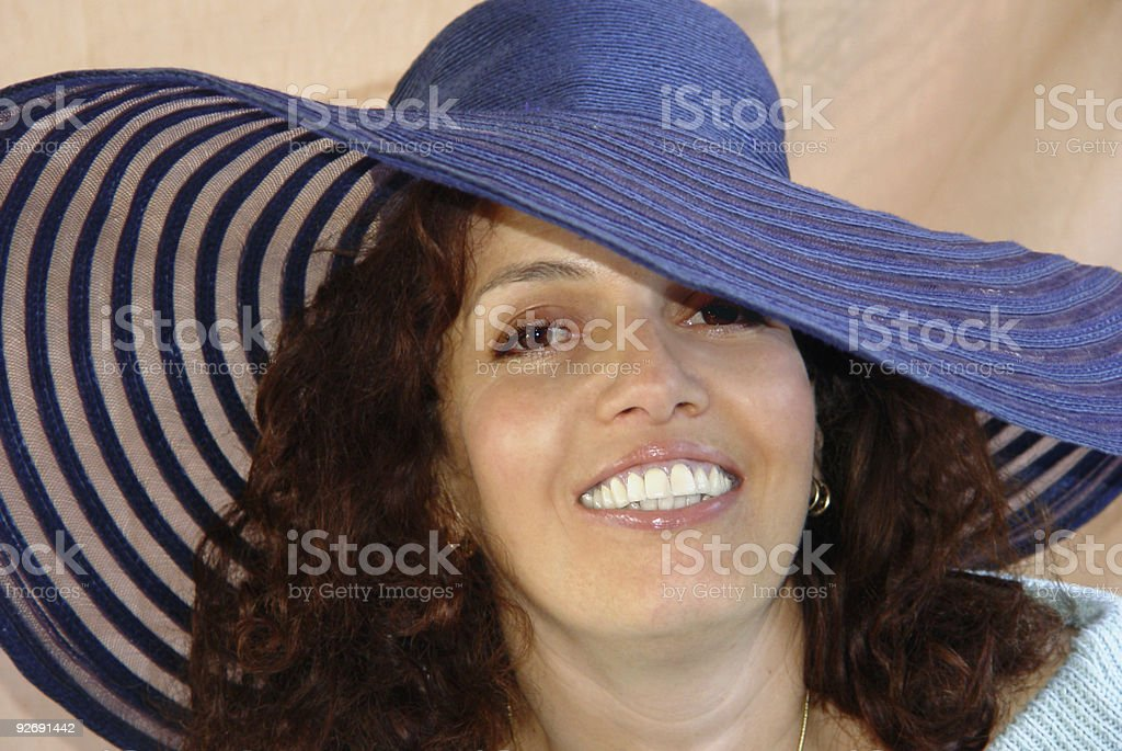 Attractive woman in a big hat stock photo