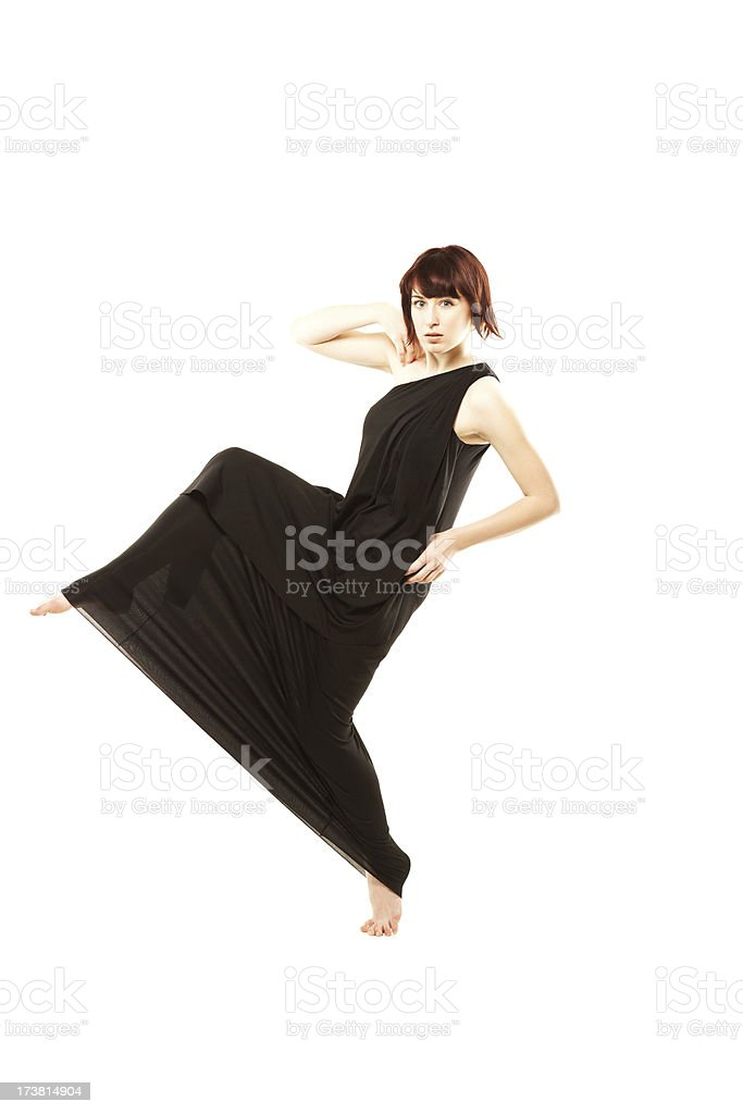 Attractive woman in black dancing isolated on white stock photo