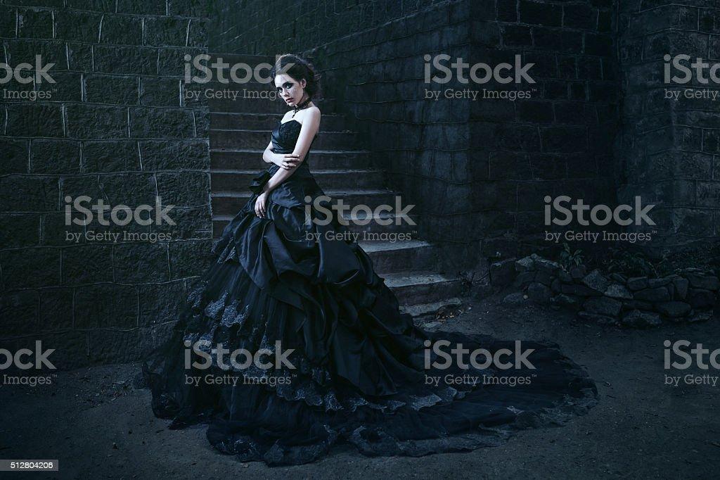 Attractive woman in black dress stock photo