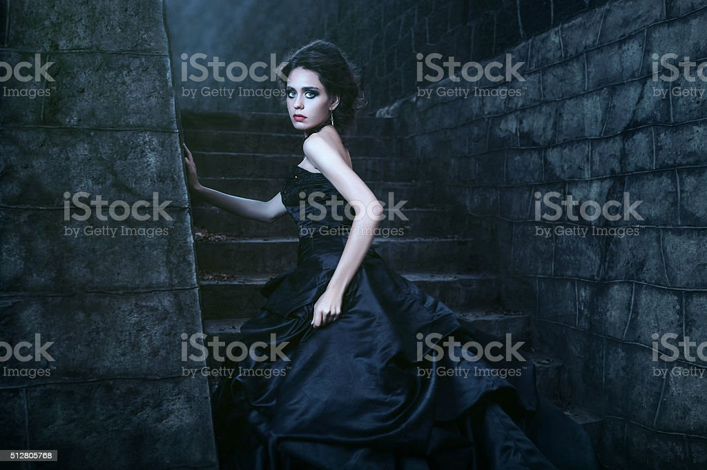 Attractive woman in black dress stock photo
