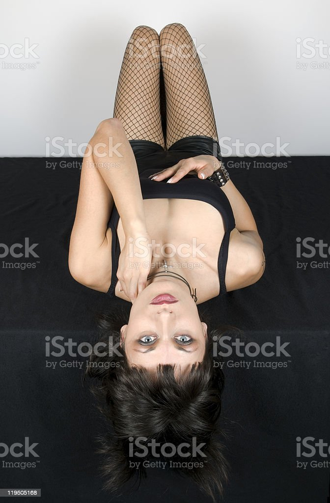 Attractive Woman in Black Lying royalty-free stock photo