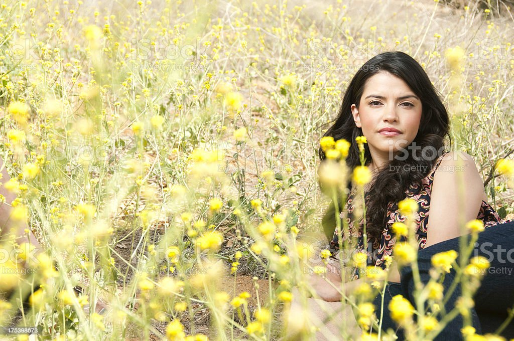 Attractive Woman in Field of Mustard Flowers stock photo