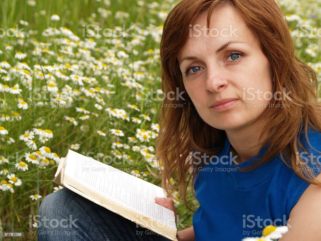 Attractive woman in meadow royalty-free stock photo